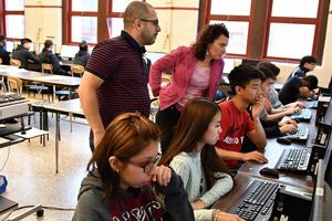 Classroom teacher, Ingrid Roche and TEALS Volunteer, Leonardo Souza (Firecracker), working with students